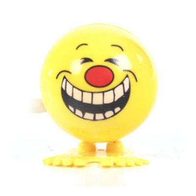 Wind Up Jumping Toy Yellow Faces